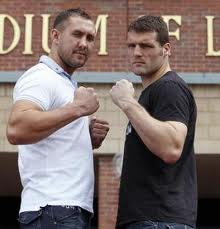 Dolan and Dickinson square off before their last fight in 2011.